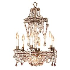 """Bronze, clear and amethyst crystal 6 light chandelier in star form with suspended basket form.  Signed Sabino, Paris. CIRCA: 1910 DIMENSIONS: 28"""" h x 17"""" w"""