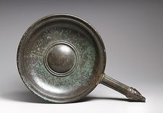 Bronze patera (shallow bowl with handle).  Period:     Early Imperial, Augustan, probably. Date:     early 1st century A.D. Culture:     Roman. Medium:     Bronze.