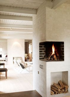 Stay Warm in Style: Modern Fireplaces | Apartment TherapyWhite on white