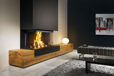 Heat Pure 90 Wood Fireplace sides) with wooden extensions. Home Fireplace, Modern Fireplace, Living Room With Fireplace, Fireplace Design, Home Living Room, Fireplaces Uk, Foyer Decorating, Great Rooms, Family Room