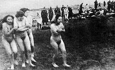 Jewish women are forced to undress and then they are executed on the Skede Beach in Libau (Liepaja), Latvia
