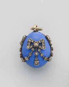 A Fabergé opaque blue enamel and diamond-set miniature pendant Easter egg, late 19th century, workmaster August Holmström decorated with ribbon-tied bows and swags set with diamonds, workmaster's initials, 56 standard height: 2.2 cm. (7/8 in.)
