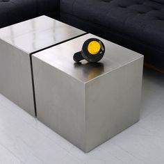 These five-sided stainless steel cubes can be used as coffee tables, end tables, or for extra seating. Each stainless steel cube is reinforced to provide extra rigidity for commercial applications. Gi
