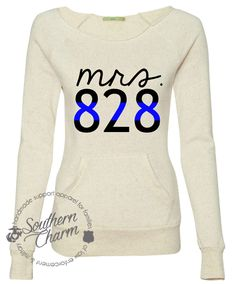 Honestly, if I win the gift card, this is the first thing I'm buying with the money! I could live in this sweatshirt! (And, not for nothing, it'd look pretty kickass in our fall wedding prep pictures!)   Southern Charm Designs - Thin Blue Line Mrs. Badge Number, $45.00 (http://www.shopsoutherncharmdesigns.com/thin-blue-line-mrs-badge-number/)