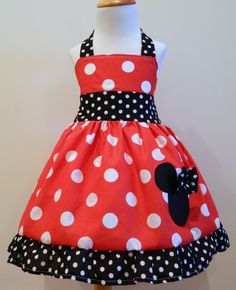 I am on the very verge of buying this dress for Lily for her birthday party.  But then I think... could I make it myself?    Minnie Mouse Dress Red And black And White Polka Dot Halter Dress 12M To 6Y. $29.00, via Etsy.