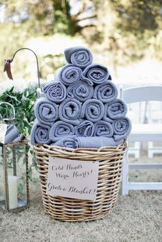 Outdoor wedding idea: for a cool spring or fall wedding, provide warm blankets or hand warmers for chilled guests. #weddingideas