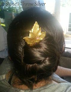 Brass hairstick in a lazy bun