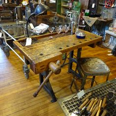 Woodworkers bench form the shop of a piano maker.. Paired with an industrial base that is adjustable.