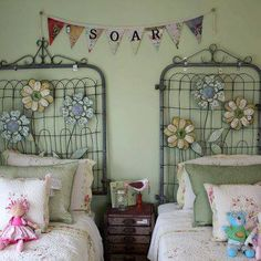 Gates/Headboards with painted metal flowers added.  Imagine these in the garden.