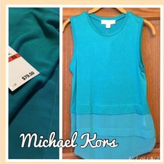 """Michael Kors blouse/tank Luxurious and soft.  This tank can be dressed up with a blazer and heels or worn casually with white shorts and flats.  Gives the illusion of triple layers, but it isn't.  Last two """"layers"""" are sheer while the main portion is not.  Gold Michael Kors emblem on the back.  Shoulder to hem is 25"""", 70% rayon and 30% lycocell.  trades/PP Michael Kors Tops Blouses"""