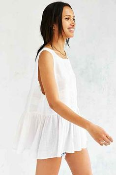 Sheer white tank with gathered bottom and very low back.
