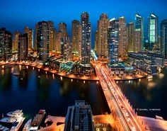 The marina in Dubai. The buildings on the background are part the Jumeirah Beach Residence (over 40 residential towers) which sits on an artificial island. The island connects to the mainland with 6 bridges along the 3km long marina.