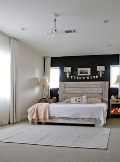 Love this bedroom. Fun light fixture. Paint looks black but I like the idea of a navy blue better. Rustic headboard. Simple bedding.