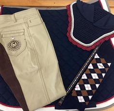 Keeping it classy, Navy Red Saddle Pad, Fly Veil and Argyle Socks. The Jess Breeches from USG in beige and a Red Barn AmberStone Browband. Make a statement....by staying simple and classy.