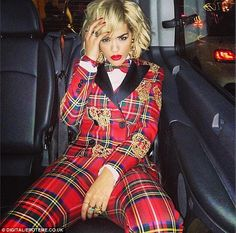 How you like me now? The singer looks stunning in her Moschino trouser suit in London on Thursday