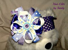 $8.00 OTT Boutique Headband in Purple, Lavender, and Liliac.  Lots of sparkle, satin, tulle, and beautiful flowers.  Now available at www.hairglitzbysandy.etsy.com
