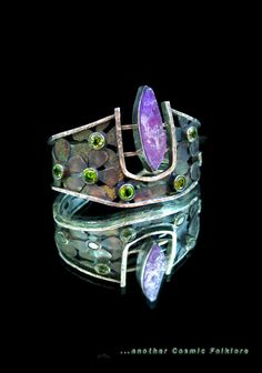 Vesica Pisces Cuff ©2011 Michael Johnson sterling silver with patina, end-cut amethyst, and two different types of cuts of faceted peridot