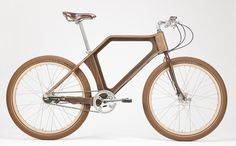 A Norfolk joiner who built the world's first 100 per cent wooden bicycle - even down to the wheels, gears and saddle – and had a friend set a world speed record on it, has launched a partially-wooden hybrid for everyday use