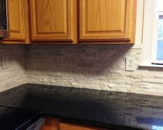 Black Granite Countertops With Tin Look Backsplash Ontario Street
