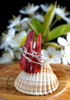 A unique, raw, predatory, handmade, wire wrapped silver ring with Nacre spikes.  Ring was designed and made by Me, using an extremely labor-intensive and precise wire-wrapping technique, with silver 925, 930 and 999. On a buyers request size can be adjusted by plus 1 or minus 1.  Dimensions: Jewelry Size: 13 EU ( 6,5 USA ) Inner diameter: 16.6 mm Width of ring: 3.4 mm Longest claw: 32 mm  You receive this unique ring in jewelry box, so it is ready to be a gift.   Refunds and Exchanges:  If…