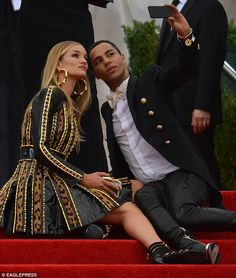 Just having a break: Rosie sat down with Balmain's creative designer Olivier Rousteing on the steps of the red carpet
