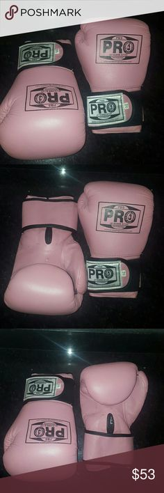 PINK PRO boxing gloves This is a set of Pro boxing gloves. 10 ounces, velcro shut in excellent condition Worn  for maybe 1 hour.  Perfect addition to a Halloween costume or use in  the ring. PBS Accessories