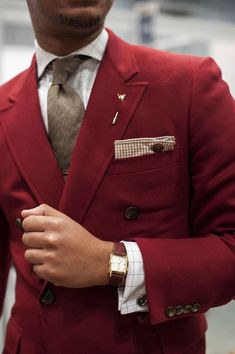 Shop this look for $54:  http://lookastic.com/men/looks/burgundy-double-breasted-blazer-and-brown-pocket-square-and-grey-tie-and-white-dress-shirt/654  — Burgundy Wool Double Breasted Blazer  — Brown Gingham Pocket Square  — Grey Wool Tie  — White Plaid Dress Shirt