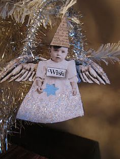 Use your kids' photos to make angel ornaments...we can dream, can't we?