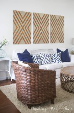 DIY Oversized Wall Art - Geometric wall art made from plywood for less than $30 for all three.