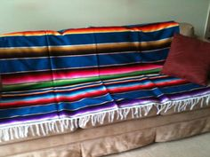 Easy decorating using a Mexican serape: http://www.stylemexican.com/mexican-blankets-sarapes.html