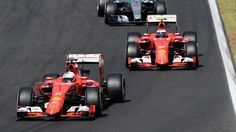 Sebastian Vettel (GER) Ferrari SF15-T leads Kimi Raikkonen (FIN) Ferrari SF15-T at Formula One World Championship, Rd10, Hungarian Grand Prix, Race, Hungaroring, Hungary, Sunday 26 July 2015.