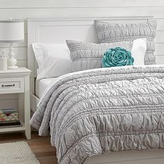 Ruched Quilt + Sham, Light Gray, twin $149. This comforter comes in a few other colors... lavender, green, white... maybe another.