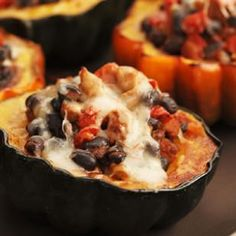 Cumin and chili powder season a filling of turkey sausage, tomatoes, black beans and Swiss cheese for creamy acorn squash.