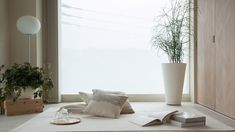 Hiroyuki Ogawa Architects divides up tiny apartment with sliding screens