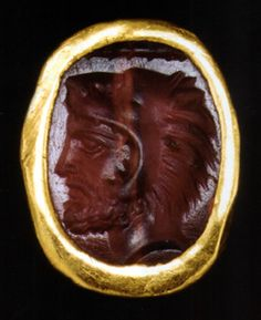 Greek ring with profile head of Herakles, carnelian and gold, 3/4 inches wide, Early Classical Period, circa mid-5th Century B.C.