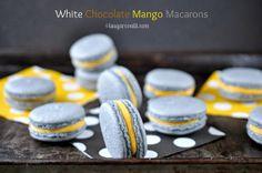 White Chocolate Ganache Mango Macarons. Shells are coloured with organic wild blueberry powder and filled with mango flavoured white chocolate ganache.