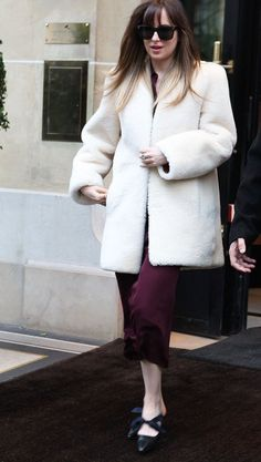Dakota leaving her hotel in Paris, France (Feb. 5th) #DakotaJohnson