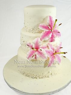 Pearl and Lily Cake - Wedding cake with pearls and sugar star gazer lilies.