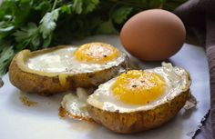 Baked Eggs in Potato Skins.  Instead of filling your potato skins with bacon and cheese opt for a baked egg! It's healthier, more filling and great for dinner!
