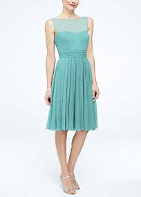 Your bridesmaids will give this short and chic dress a fierce and fiery attitude!  Sleeveless mesh bodice features ultra-feminine sweetheart illusion neckline.  Ruched band helps cinches the waist while creating a stunning silhouette.  Short flowy skirt hits right above the knee.  Fully lined. Back zip. Imported polyester. Dry clean only. To protect your dress, try our Non Woven Garment Bag.
