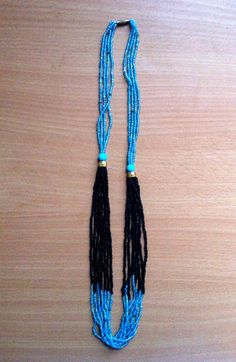 Handmade beaded necklace, blue/black. 100% of sales go to support the Youth Education Network of Kenya - www.yenkenya.org