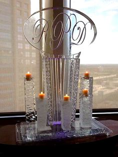 Beautiful monogram ice sculpture with ice candle holders for a wedding at the Citrus Club in Orlando.