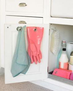Under-the-Sink Organizer; Don't let kitchen rags and dishwashing gloves clutter the sink area. Instead, hang them from hooks screwed to the inside of a cabinet door, where the items can stay out of sight as they dry. Organisation Hacks, Kitchen Organization, Kitchen Organizers, Household Organization, Kitchen Storage, Cabinet Organizers, Vanity Organization, Bathroom Storage, Cleaning Hacks