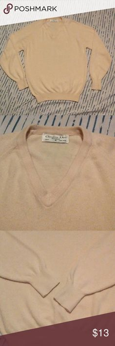 Christian Dior Medium V Neck Cream Sweater! This sweater is in great condition. Brand is Christian Dior. A trusted brand for quality products. Pictures show front, back, and tag/collar. Goes great with the bundle option. Has some lint around sleeves. Christian Dior Sweaters V-Neck