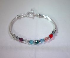 The bracelet shown in this listing is an example of a grandmother with 7 grandkids. The crystals are 6mm Swarovski rounds spaced with silver heishi beads. If you know the size you need, I can make it with a toggle clasp. If not, I can make the bracelet adjustable (with a lobster clasp and an extension chain).  The number crystals determines the size of the bracelet. The bracelet shown here was made to fit a 7.0 wrist. If you need a larger or smaller size, let me know. I can manipulate the…