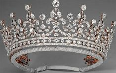 girls of great britain and ireland tiara  a wedding present for princess may of teck (the future queen mary) from the 'girls of great britain and ireland', the diamond tiara was purchased from garrard with money raised by a committee chaired by lady eve greville; in 1947, mary gave the diamond and silver tiara to her granddaughter, the future queen elizabeth II, as a wedding present