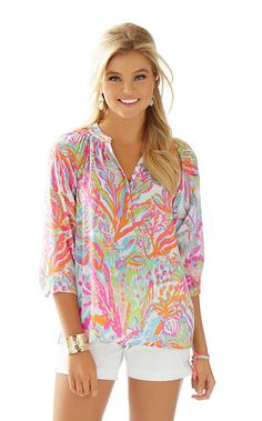 Get ready for a style epiphany: this silk blouse is the secret workhorse of your closet. You can wear the Elsa Top - Scuba To Cuba tucked in or worn out, sleeves pushed up or blissfully long, styled with a belt over leggings, peeking out from under a blazer, draped over the top of a pencil skirt...Elsa is one shirt with an endless number of looks year-round. This season, we're making Elsa's job a little easier by bringing you bright new prints and colors to spice up your collection.