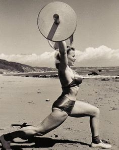 bad ass vintage chick lifting weight;    i want a 100lbs clean and jerk