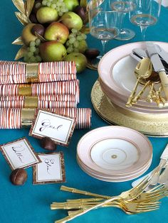Image above: Flatware by Ricci. Napkin fabric by Steve McKenzie. Place-setting cards created by gluing paper labels on top of marbled bookbinding paper. Place cards are then inserted into a halved chestnut with a slit cut in the top to hold the card.