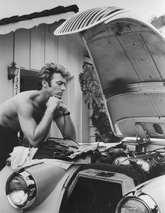 A young (shirtless) Clint Eastwood working on a car engine...